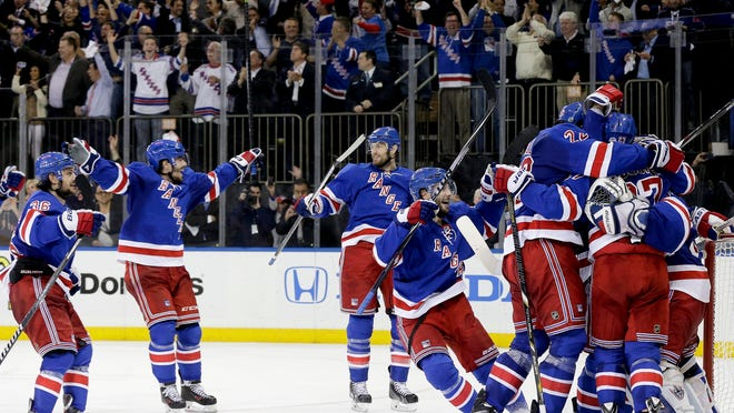 Rangers players on the ice and fans behind the glass celebrate together after the 1-0 victory over the Montreal Canadiens in Game 6 of the Eastern Conference final Thursday night. The Rangers advance to the Stanley Cup final, starting next Wednesday.