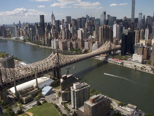 636319234743565642-17-AA-NEW-YORK-CITY-24-wide-shot-of-Roosevelt-Island-Tramway-and-the-Queensboro-Bridge.jpg