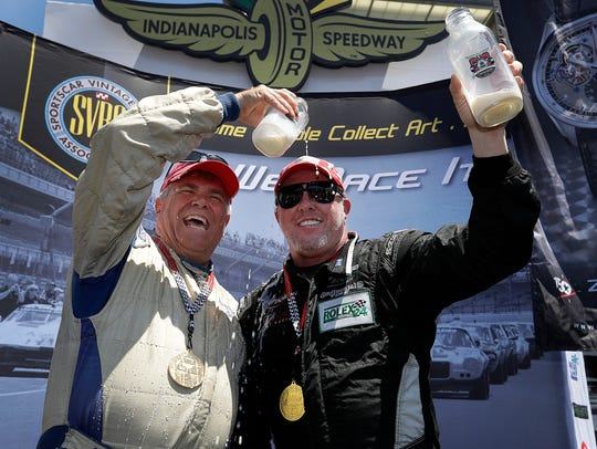 Paul Tracy and teammate Gary Moore (left) shown in 2016 at Indianapolis Motor Speedway.