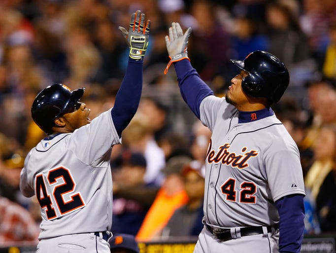Tigers'  Rajai Davis, left, 2 celebrates his solo home