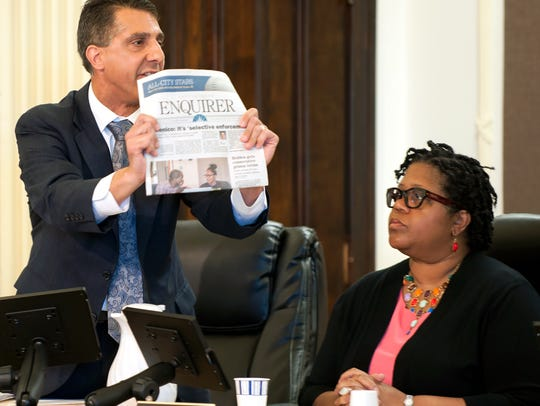Commissioner Jeff Domenico holds up a recent edition