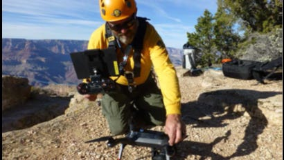 A drone operator at Grand Canyon National Park prepares to launch one of the park's drones.