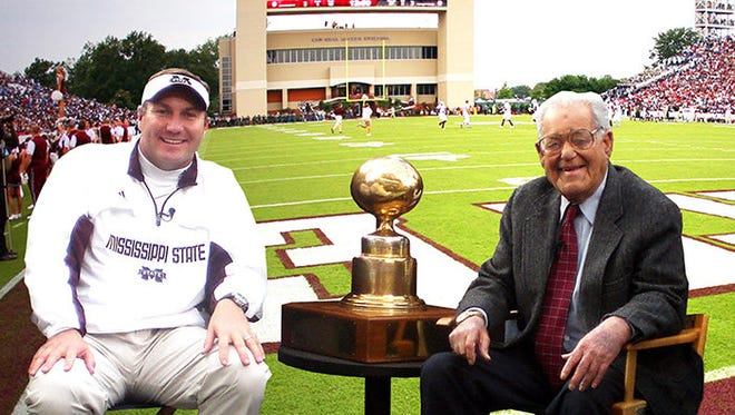 MSU Head Football Coach Dan Mullen, left, with broadcaster Jack Cristil, right, after the first of two consecutive Egg Bowl victories over the Ole Miss Rebels in 2009 and 2010.