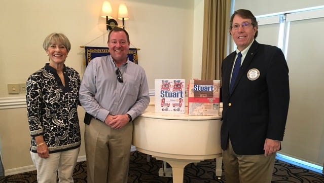 """Rotarians Ellen Peitz, Chris Shoaf and John Gonzalez are preparing the three prize books for Friday, Oct 7 drawing for the winner of the """"Be a Tourist in Stuart"""" fundraiser."""