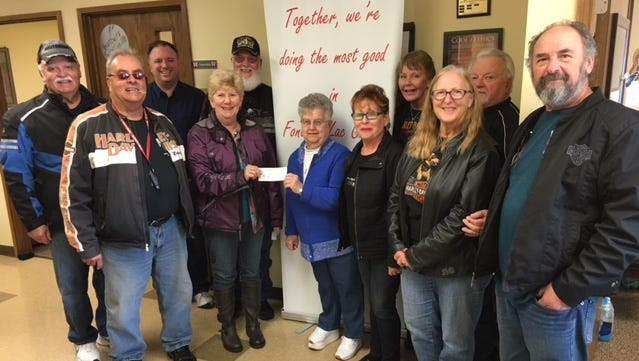 Open Road  HOG Chapter #2166 members gather with Salvation Army Christmas team coordinators Ron Jacobson, back row, second from left, and Barb Thill, accepting check, to share funds to help The Salvation Army of Fond du Lac provide Christmas to families in need. The Charity Club has also provides funds.
