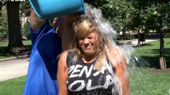 Bob Kravitz and Dana Benbow participated in the Ice Bucket Challenge to raise money for ALS Association.