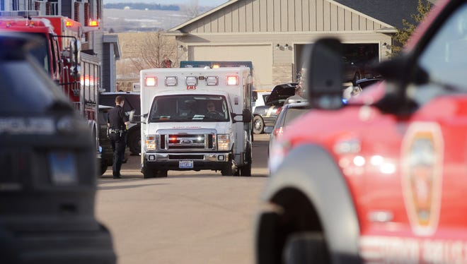 An ambulance leaves the scene of a shooting outside of an apartment on the 9400 block of W. Karmya Circle in southwestern Sioux Falls Friday, Feb 26, 2016