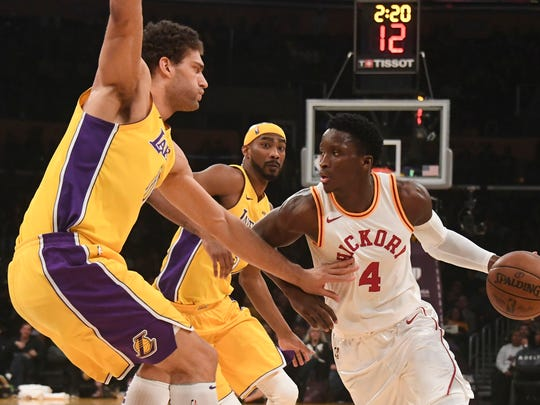 January 19, 2018; Los Angeles, CA, USA; Indiana Pacers guard Victor Oladipo (4) dribbles the basketball against Los Angeles Lakers center Brook Lopez (11) and forward Corey Brewer (3) during the first half at Staples Center. Mandatory Credit: Richard Mackson-USA TODAY Sports