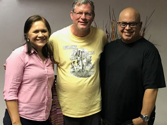 Mike Woodard, center, and two members of Primera Iglesia Bautista in Utuado, Puerto Rico, take a break from installing a water purification system that filled the baptistry with fresh water.