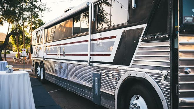 Exterior of Cozy the Motorcoach. With a little help from the community, Cozy the Motorcoach has become quite the party bus.