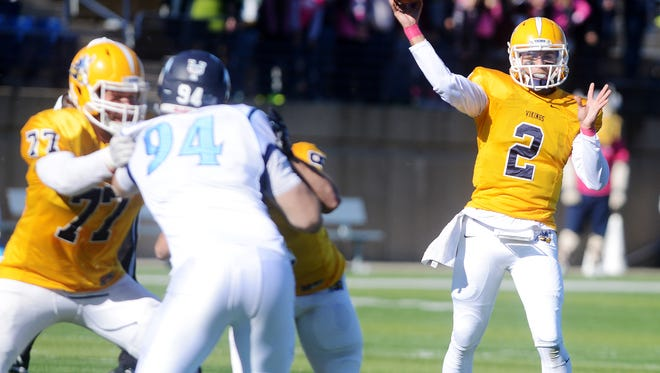 Augie quarterback, Trey Heid, throws a pass as they play Upper Iowa in Saturday's game at Kirkeby Over stadium, Oct 31, 2015.