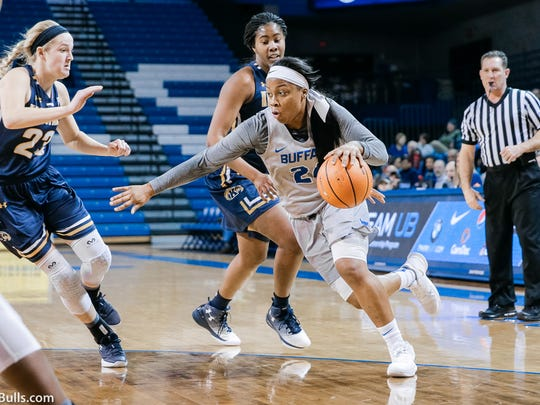 Gates Chili's Cierra Dillard, right, leads the UB Bulls in scoring at 15 points per game and assists at 5.3 while also grabbing 3.9 rebounds per game.