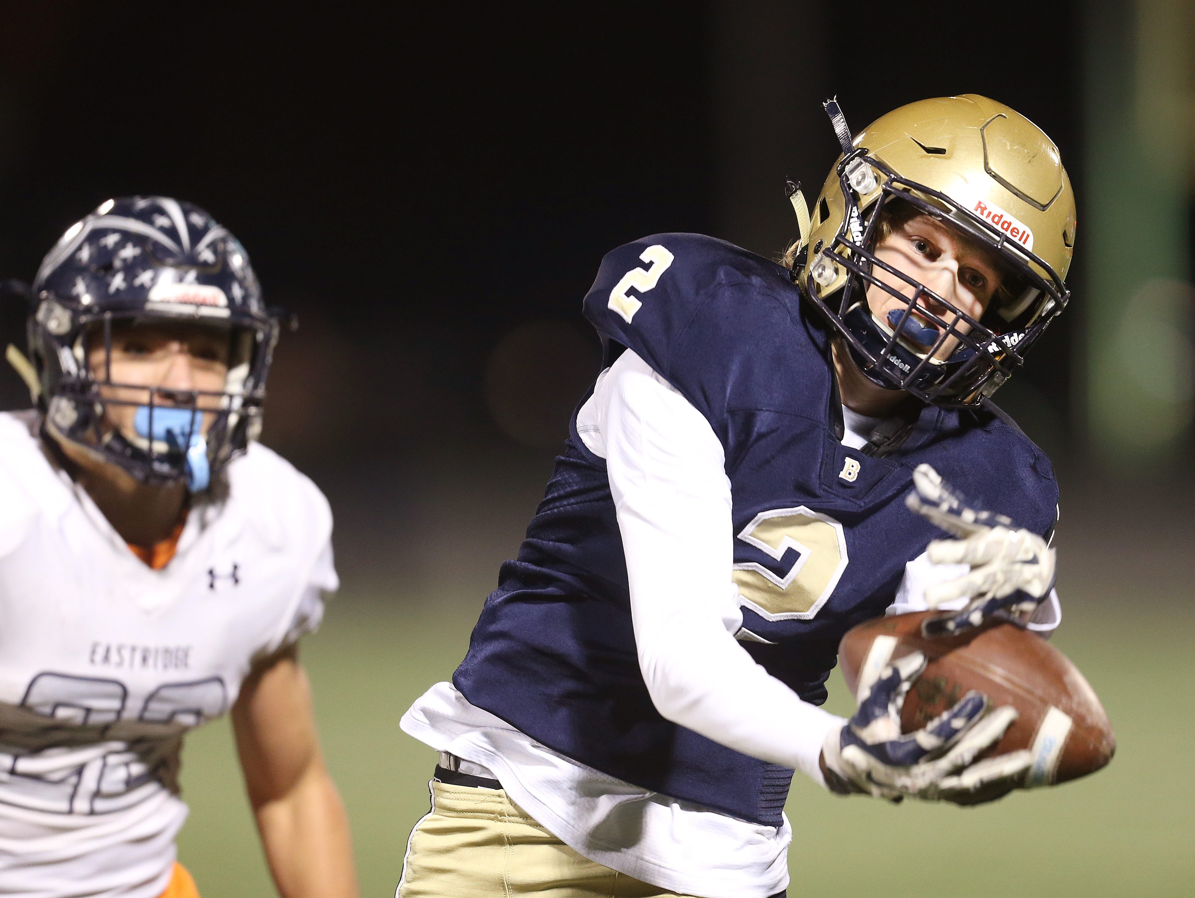 Brighton receiver Noah Shinaman (2) makes an over the shoulder catch on this deep pass against Eastridge's Jake Trykoski (22). The play set up a second quarter touchdown.
