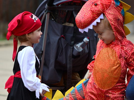 Luna Miller, 22 months from Springettsbury, left, checks out Milo Grippi's, 2 of Spring Garden, tail of his dinosaur costume before the 66th York City Halloween Parade, Sunday Oct. 25, 2015.  John A. Pavoncello - jpavoncello@yorkdispatch.com