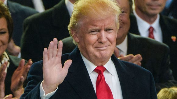 President Donald Trump waves from the Lafayette Park