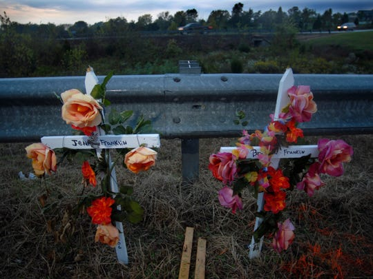 Crosses honoring accident victims Jenilyn Addis Franklin, 18, and her husband Brandon Franklin, 21, stand on U.S. 411 Oct. 11, 2006 near Sevierville, Tenn. The memorial marks the place where an automobile crash claimed the lives of the newlyweds on Sept. 26, 2006. (Clay Owen / News Sentinel)