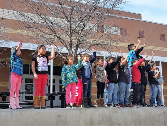 Mescalero first graders wave goodbye to the butterfly.
