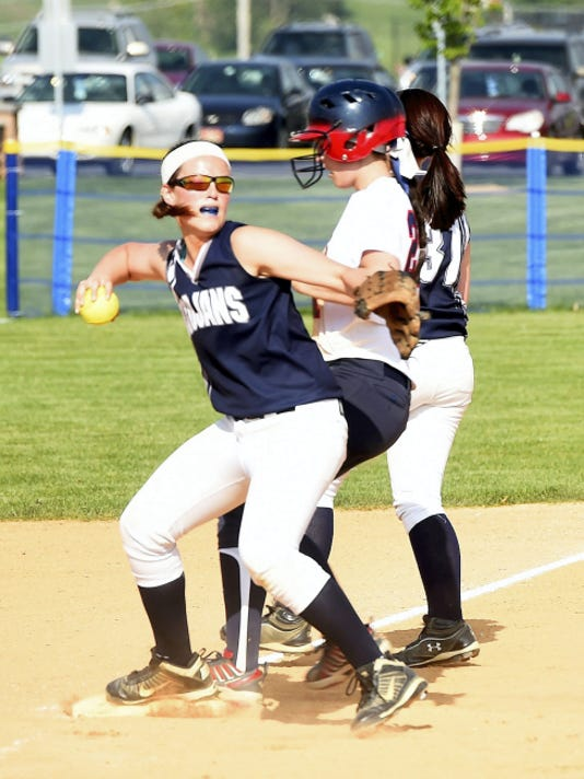 Chambersburg third baseman Tara Harmon (6) steps on third for an out during the Trojans' 12-2 victory over Red Land on Thursday at Norlo Park.