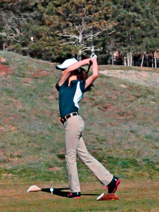 Ruidoso High School girls golf team member Alexandra Michelena watches it fly during a recent tournament.