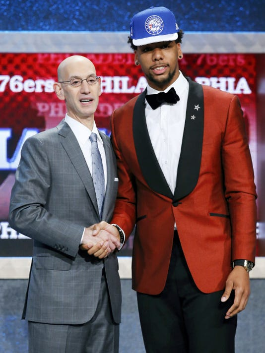 Kathy Willens — The Associated Press Jahlil Okafor, right, poses for a photo with NBA commissioner Adam Silver after the Philadelphia 76ers selected Okafor with the third pick during the NBA basketball draft, Thursday, June 25, 2015, in New York.