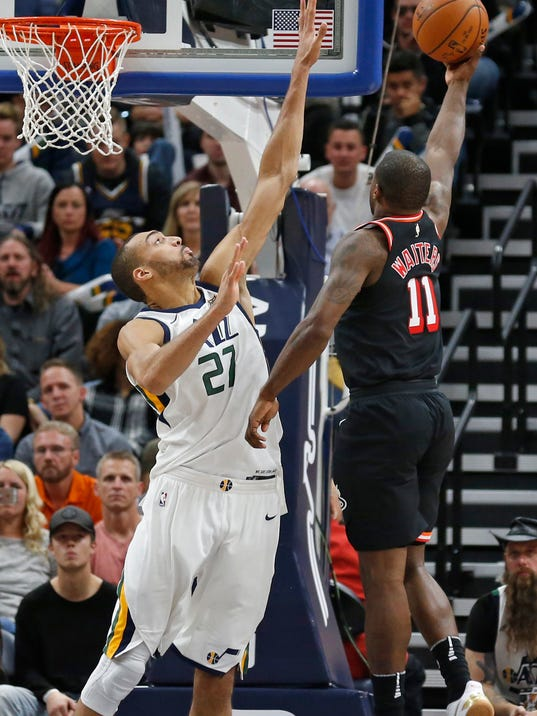 Miami Heat guard Dion Waiters (11) lays the ball up as Utah Jazz center Rudy Gobert (27) defends in the second half during an NBA basketball game Friday, Nov. 10, 2017, in Salt Lake City. (AP Photo/Rick Bowmer)