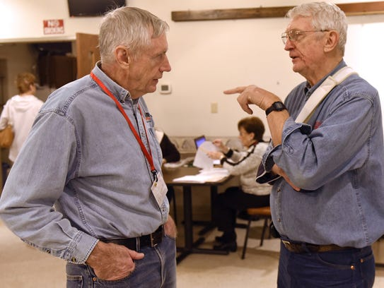 Larry McCarthy, left, talks to Roger Schwalm during