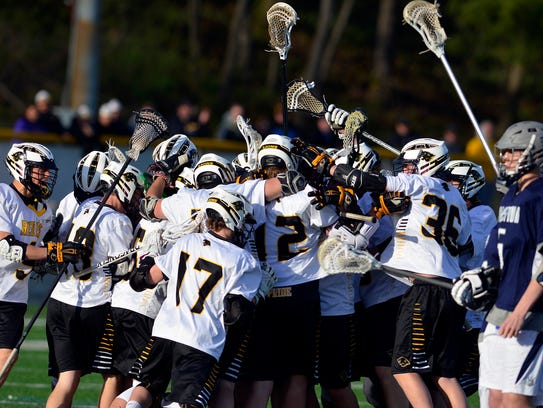 Red Lion celebrates after defeating Dallastown in overtime7-6