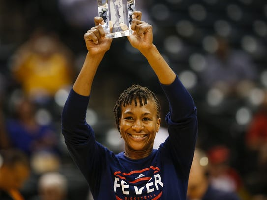Indiana Fever forward Tamika Catchings (24) is awarded