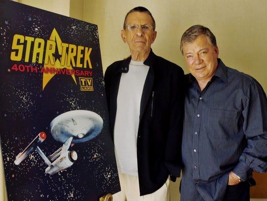 Leonard Nimoy, left, and William Shatner pose Aug.