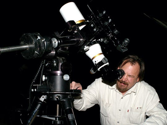 Jerry Gaber, a member of the Astronomical Society of Las Cruces, gazes through his telescope at the star Betelgeuse at Hillrise Elementary School in this 2008 file photo. ASLC regularly hosts outreach events at schools in which students can peer through telescopes at stars and planets in the night sky.