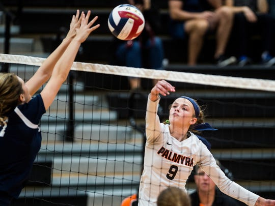 Palmyra's Taylor McInerney goes for the spike against Wyomissing's Rachel Shirk as Palmyra defeated Wyomissing 3-0 in the first round of the PIAA District III volleyball tournament on Saturday, Oct. 28, 2017.