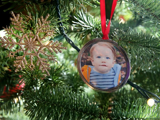 An ornament bearing Lemuel's photo hangs from the Houston