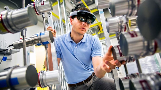 Michael Hamel, NERS Ph.D. Student, uses a Microsoft Hololens headset with a radiation imaging array to demonstrate the use of augmented reality to find nuclear materials hidden in a room.