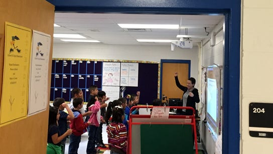 Students in a WIN Academy class get energized for a