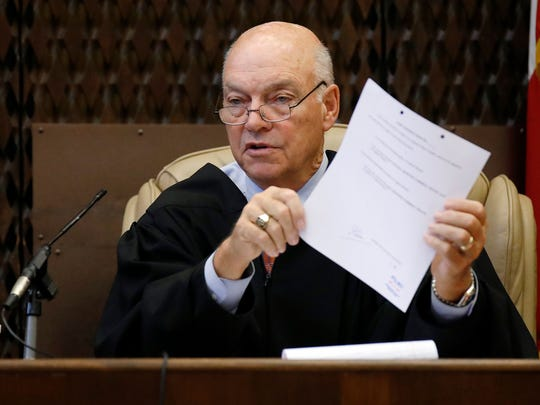 Circuit Judge Gerald Chatham instructs the jury on the paperwork that must be filled out when they reach a verdict in the capital murder trial of Quinton Tellis, during court Sunday, Oct. 15, 2017, in Batesville, Miss. Tellis is charged with burning Jessica Chambers to death almost three years earlier. Tellis pleaded not guilty and did not testify during the trial.