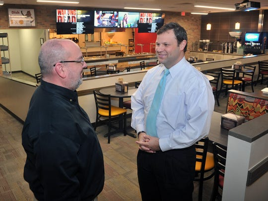 Lee Thurman, left, and Matthew Park in the new Maverick's Corner space of the Clark Student Center at Midwestern State University. Thurman is the director of dining services and Park is the associate vice president of student affairs. MSU has  spent $5 million on upgrading, remodeling and expanding the food service options on campus.