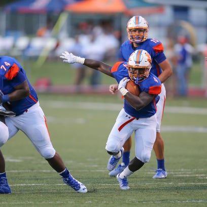 Madison Central's Gabe Short (4) finds a hole in the