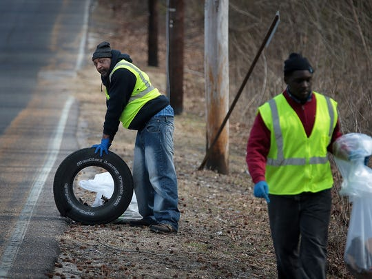 Dwayne Watkins (left), David Murray and a crew of fellow Work Local recruits clean up along Mitchell Road in the Westwood area Tuesday morning. Work Local which pays homeless people to clean up blight Downtown is expanding its hours, days of service and focus area with funding from the Downtown Memphis Commission and the Memphis Convention & Visitors Bureau.