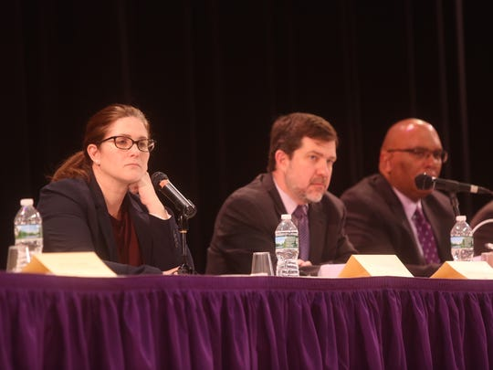 New Rochelle Board of Education President Rachel Relkin, left, Superintendent Brian Osborne, center, and New Rochelle High School Principal Reginald Richardson listen to speakers at a public forum on school violence earlier this year.