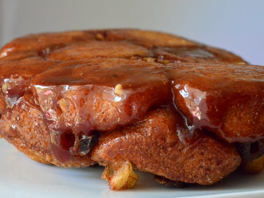 Apple Walnut Monkey Bread is my twist on a classic; it is covered in caramelized sugar and stuffed with apples, walnuts and dates