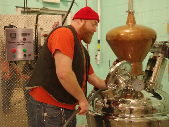 Distiller Dean Browne works at the pot still at Rowhouse Spirits in Kensington section of Philadelphia.