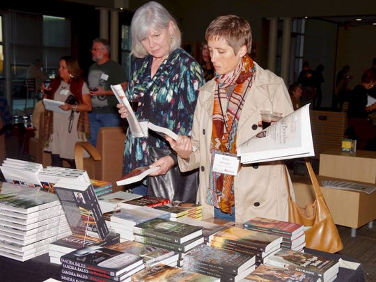 Southeast WI Festival of Book attendees find treasures amongst the Festival authors' books being sold.