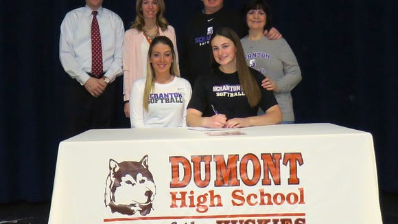 Jennifer Sweeney has signed to play softball next year at Scranton University in Pennsylvania. Standing, from left: Athletic Director Michael Oppido, guidance counselor Jackie Bello, Jennifer's father, Jim; and her mother, Rosanne. Sitting, from left: Jennifer's sister, Julie; and Jennifer Sweeney.