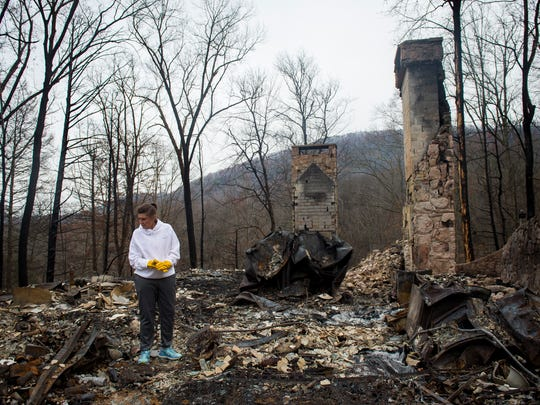 Former Lady Vol Lisa McGill Reagan looks for personal belongings she could save in the rubble of her home in Gatlinburg on Saturday, Dec. 3, 2016.