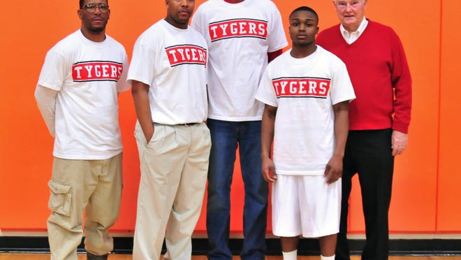 Ken McCally, the first Mansfield Senior player to top 1,000 points, was honored with four others in the seven-member club during a 2013 game. McCally is joined by, from left, Ahmed Kent, Marquis Sykes, Dapreis Owens and Keon Johnson.