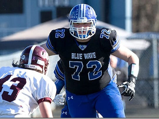 Andrew Stueber is a three-star offensive tackle from