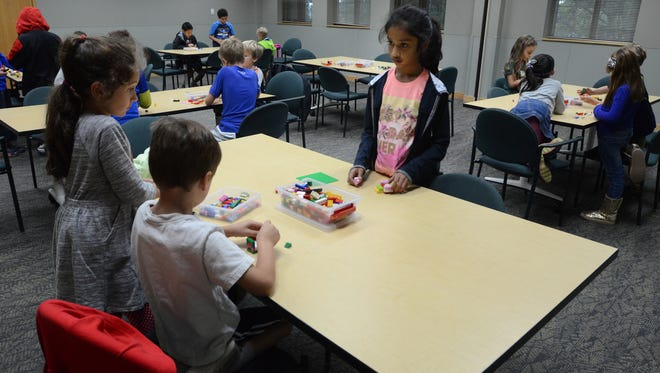 Kids gather at the Northville District Library on Sept. 28 for its monthly Lego Time session.