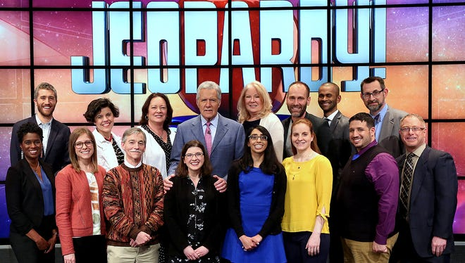 Watkins Glen teacher Rachel Niegelberg, third from right, joins Jeopardy! host Alex Trebek and other teachers who took part in a recent teachers tournament on the game show.