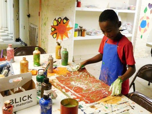 636346837744150466-PJ-Moye-created-a-painting-inspired-by-Jackson-Pollock.JPG