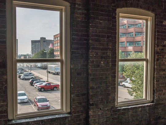 The Carlyle Building at 15 Carlyle St. in Battle Creek has many windows with views of the downtown area, including this one that shows the Kellogg Co. headquarters and the McCamly Plaza Hotel.